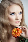 Beautiful woman with a rose. In his hand Royalty Free Stock Image