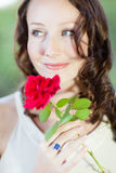 Beautiful woman with a rose Stock Photography