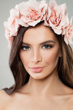 Beautiful Woman with Rose Flower Wreath. Spring Beauty. Long Hair and Fashion Makeup. Perfect Girl with Flowers Hairstyle Stock Photos
