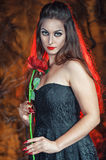Beautiful woman with rose in halloween style Royalty Free Stock Image