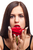 Beautiful woman with rose in hand on white Stock Photos