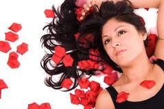 Beautiful woman with rose peta Stock Photography