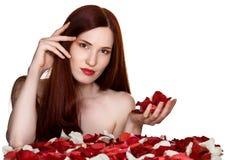 Beautiful woman and rose petals Stock Photos