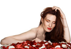 Beautiful woman and rose petals Royalty Free Stock Images
