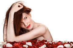 Beautiful woman and rose petals Stock Images
