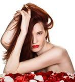 Beautiful woman and rose petals Stock Photo