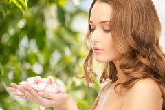Beautiful woman with rose petals Royalty Free Stock Image
