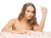 Beautiful woman with rose petals. Picture of beautiful woman with rose petals Stock Photography