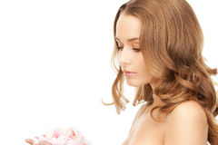 Beautiful woman with rose petals. Picture of beautiful woman with rose petals Royalty Free Stock Images