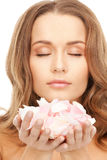 Beautiful woman with rose petals. Picture of beautiful woman with rose petals Royalty Free Stock Image