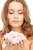 Beautiful woman with rose petals. Picture of beautiful woman with rose petals Royalty Free Stock Photos