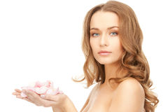 Beautiful woman with rose petals. Picture of beautiful woman with rose petals Royalty Free Stock Photo