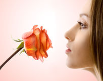 Beautiful woman with rose sideview stock images