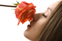 Beautiful woman with rose sideview isolated Stock Photo
