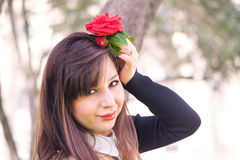 Beautiful woman with rose. Young beautiful woman with rose under the tree Royalty Free Stock Photography