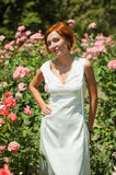Beautiful woman in roses garden Royalty Free Stock Image
