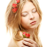 Beautiful woman with roses in hair Royalty Free Stock Photography