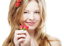 Beautiful woman with roses in hair Royalty Free Stock Images
