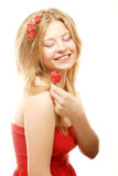 Beautiful woman with roses in hair Stock Photo