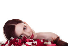 Beautiful woman and roses petals Royalty Free Stock Image