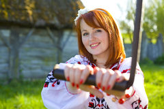 Beautiful woman rotates handle Stock Photo