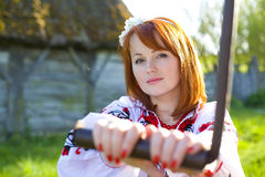Beautiful woman rotates handle Royalty Free Stock Image