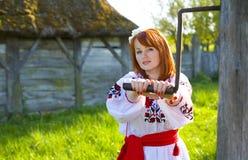 Beautiful woman rotates handle Royalty Free Stock Photo