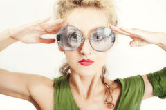 Beautiful woman in the round gray sunglasses Stock Photos