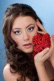 Beautiful woman with rowan berry Royalty Free Stock Photography
