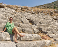 Beautiful woman on the ruins of the Colosseum. Turkey, Kemer Stock Photo