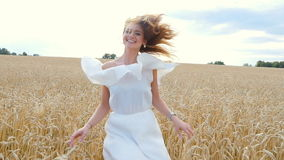Beautiful woman run away in wheat field stock video footage