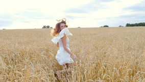 Beautiful woman run away in wheat field stock video