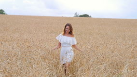 Beautiful woman run away in wheat field stock footage