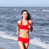 Beautiful woman running. On the beach Stock Photo