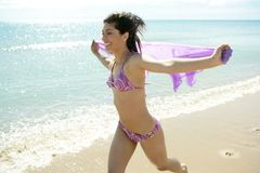 Beautiful woman running in bikini on the beach Royalty Free Stock Photos