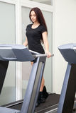 Beautiful woman running in a gym Royalty Free Stock Photos