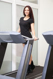 Beautiful woman running in a gym Royalty Free Stock Image