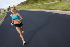 Beautiful Woman Running & Listening to MP3 Player Stock Photo