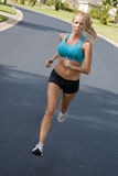 Beautiful Woman Running & Listening to MP3 Player Stock Image