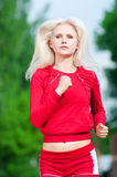Beautiful woman running in park Royalty Free Stock Photography