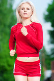 Beautiful woman running in park Stock Image