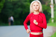 Beautiful woman running in park Stock Photo