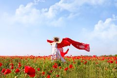 Beautiful woman running in poppy field Royalty Free Stock Images