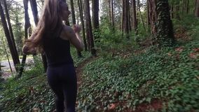 Beautiful woman running scared in the mountains stock video