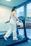 Beautiful woman running on treadmill Royalty Free Stock Photos