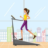 Beautiful woman running on treadmill Royalty Free Stock Photography