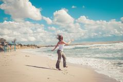 Beautiful woman runs on the beach. royalty free stock photos