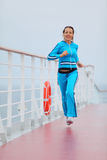 Beautiful woman runs on cruise liner deck Royalty Free Stock Images