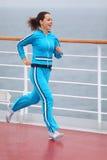 Beautiful woman runs on cruise liner deck Stock Photo