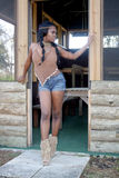 Beautiful Woman in a Rustic Cabin Stock Images